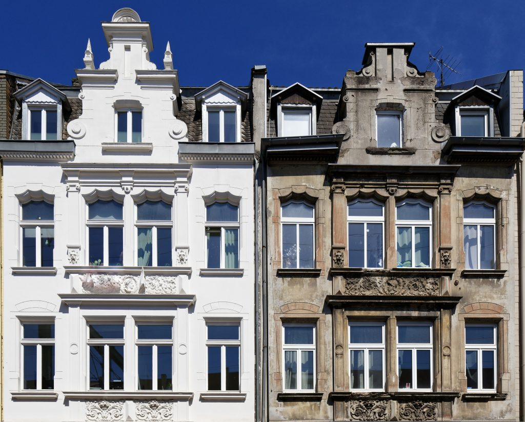 renovated and not renovated old building twins in cologne germany
